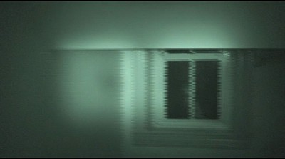 A face begins to appear in the window in this frame of a video shot from the third floor stairwell at Historic Jordan Springs Event & Cultural Centre by team investigator Joel Collett.